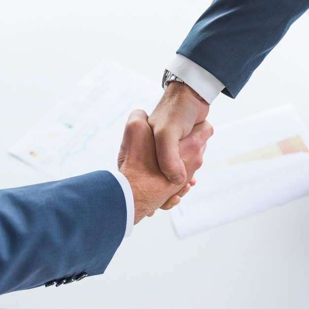 Top view of business people shaking hands together Free Photo
