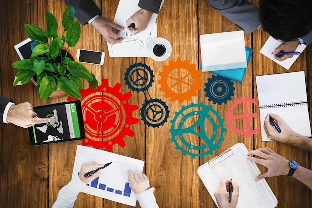 Top view of businesspeople working with icons painted on the table Free Photo