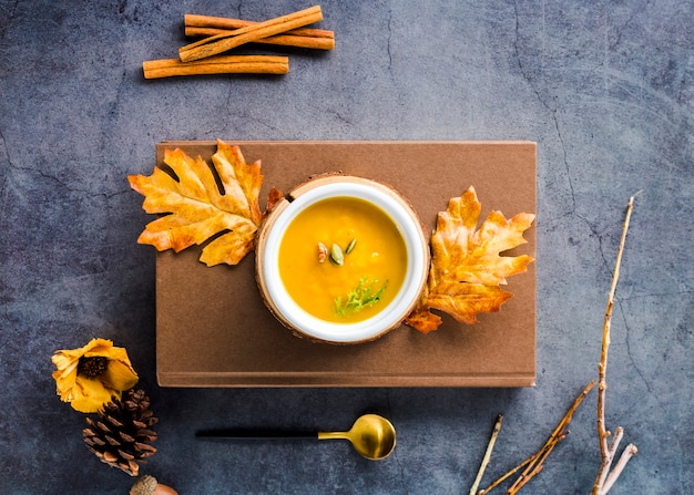 Top view butternut squash soup on wooden board Free Photo