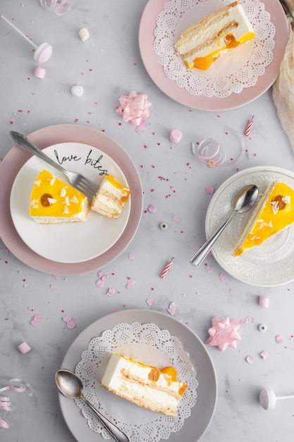 Top view of cake slices on plates with cutlery Free Photo