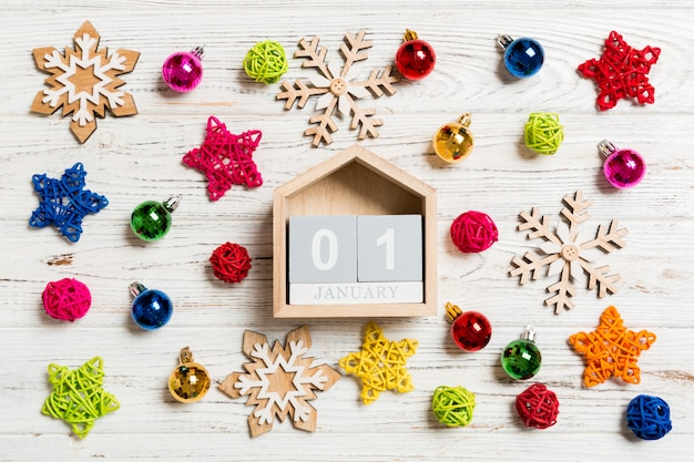 Top view of calendar on christmas wooden. Premium Photo