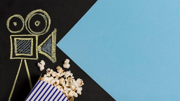 Disegno della fotocamera vista dall'alto con popcorn Foto Gratuite