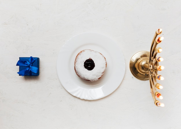 Top view candleholder and sweets Free Photo