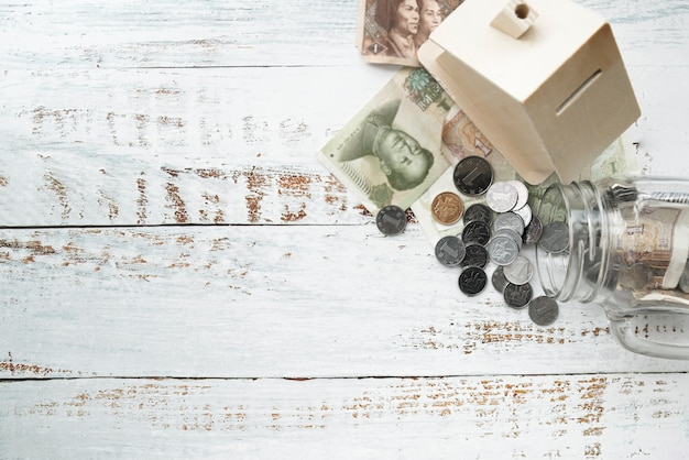 Top view cash with moneybox and jar Free Photo