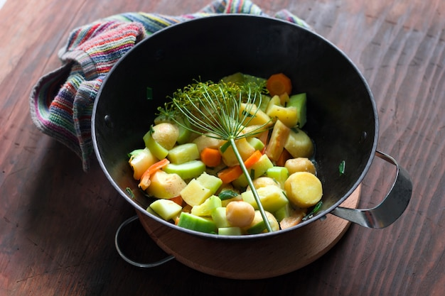 Top view of cauldron with hot stew of seasonal vegetables Premium Photo
