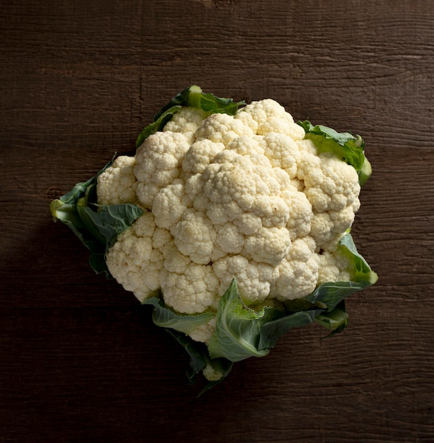 Top view cauliflower with leaves Free Photo