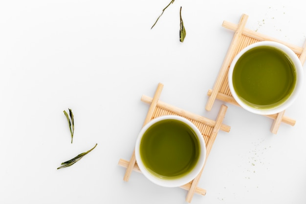 Top view ceramic cups with matcha tea Free Photo