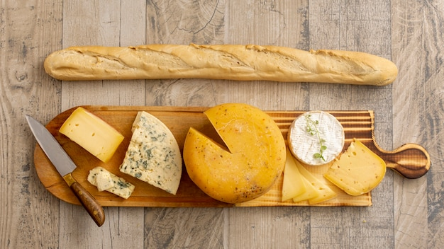 Top view cheese and brie with a baguette Premium Photo
