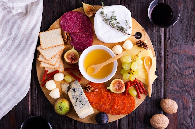Top view cheese and snacks on a table Free Photo
