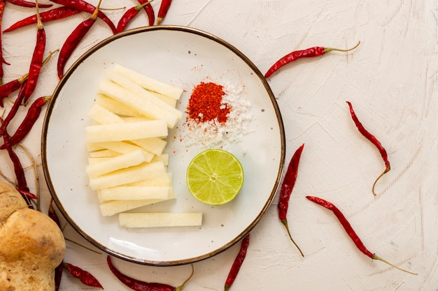 Top view cheese with red hot chilli peppers Free Photo