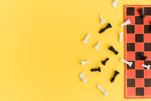 Free Photo Top View Chessboard On Yellow Background