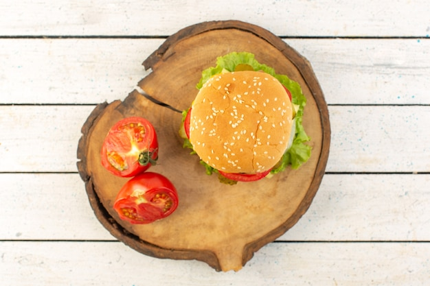 A top view chicken burger with cheese and green salad Free Photo