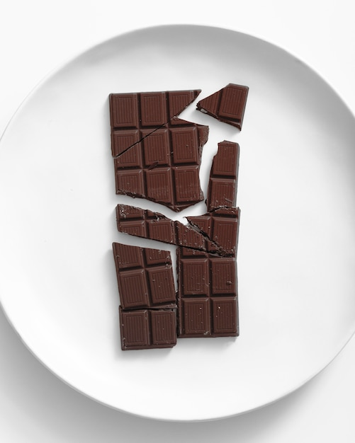 Top view of chocolate bar on plate Free Photo