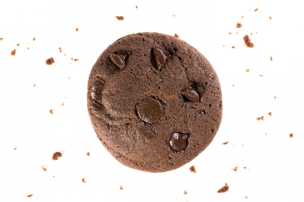 Top view of chocolate cookies with chips isolated on white , flat lay of dessert and sweet Premium Photo