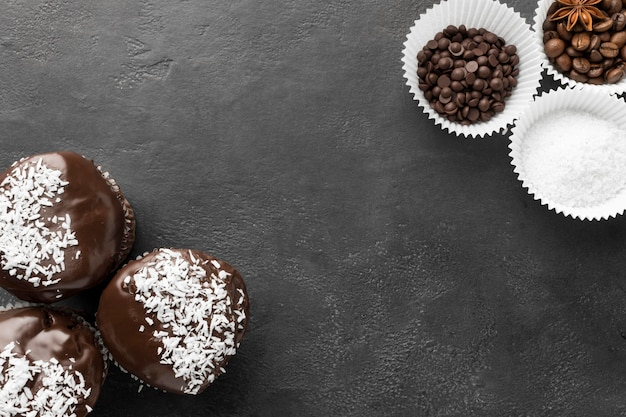Top view of chocolate desserts with coffee beans Free Photo