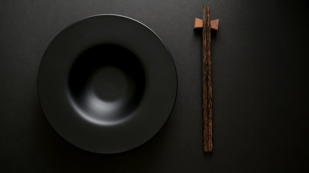 Top view of chop stick and empty plate Premium Photo