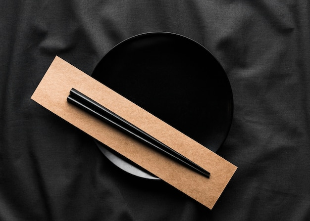 Top view of chopsticks on plate Free Photo
