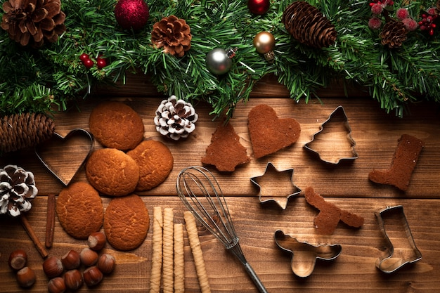 Top view christmas biscuits with ustensils Free Photo