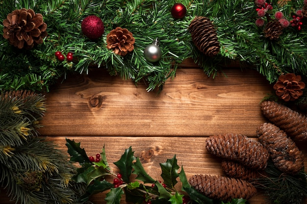 Top view christmas decoration with wooden background Free Photo
