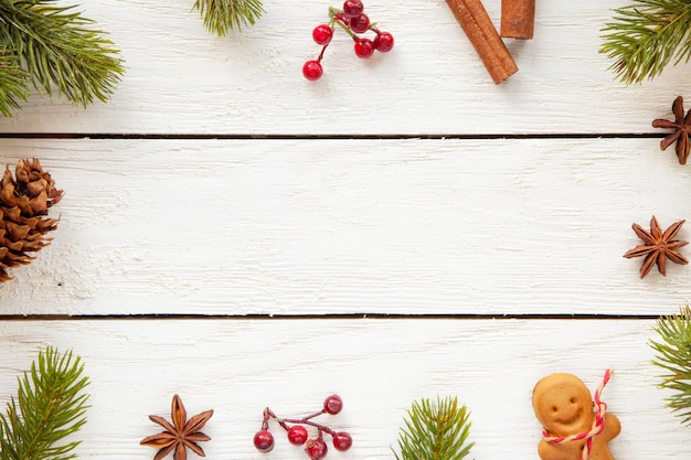 Top view of christmas decorations and food on a wooden surface with copy space Free Photo