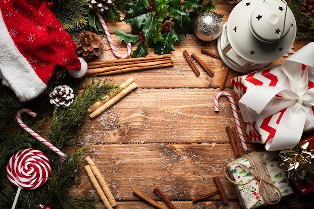 Top view christmas decorations with wooden background Free Photo