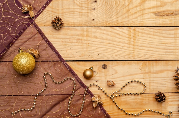 Top view of christmas decorations on a wooden texture Free Photo