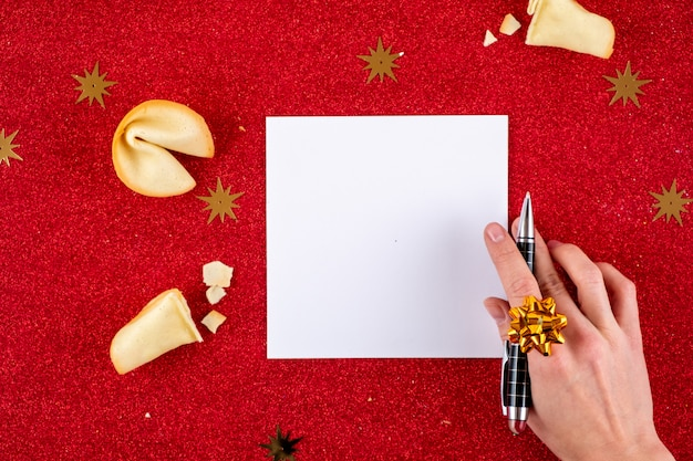 Top view of christmas letter in santa claus hand. Premium Photo
