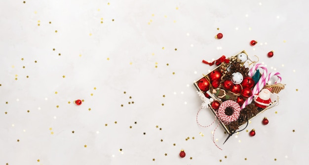 Top view of christmas props tree toys in a box over on white background with copy space. Premium Photo