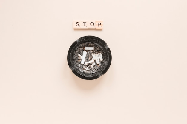 Top view cigarettes and ashtray Free Photo