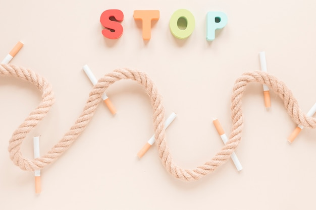 Top view cigarettes and rope Free Photo