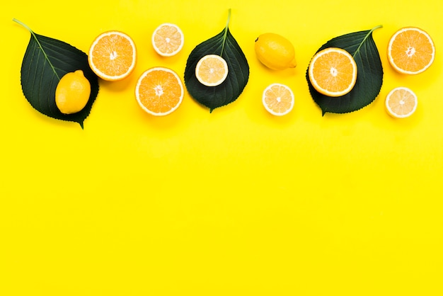 Top view of citrus fruits with leaves Free Photo