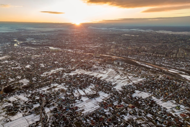 Top view of city suburbs or small town nice houses on winter morning on cloudy sky . Premium Photo