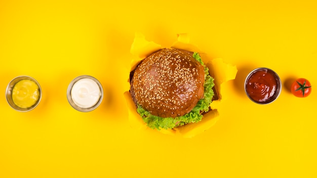 Top view classic burger with various dips Free Photo