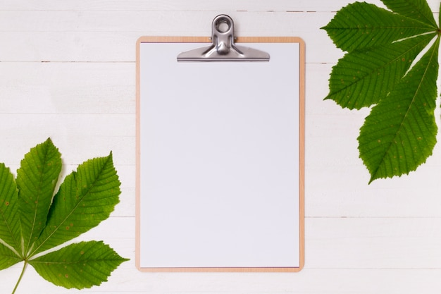 Top view clipboard mock-up with leaves Free Photo