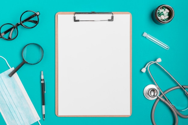 Top view clipboard surrounded by stethoscope Free Photo