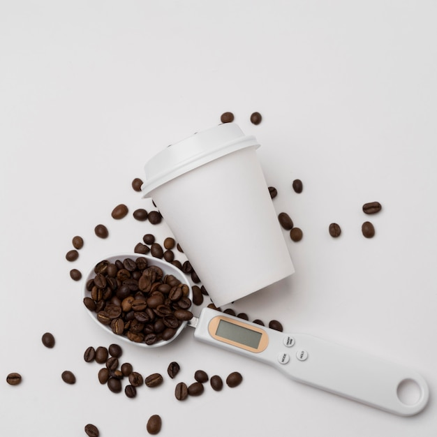 Top view coffee beans and cup arrangement Free Photo