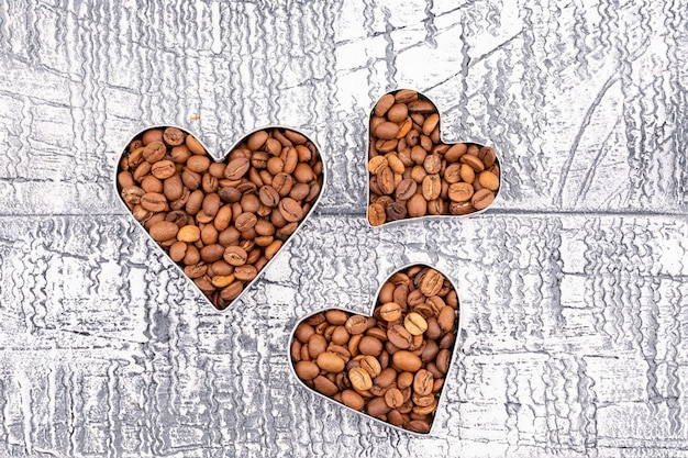 Top view coffee beans heart shape on retro surface Free Photo