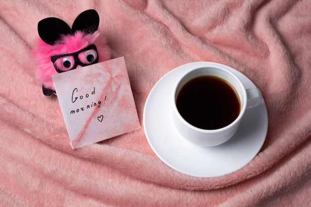 Top view coffee cup on a pink blanket Premium Photo