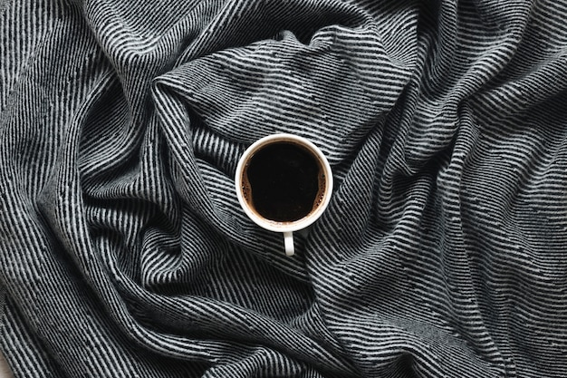 Top view of a coffee cup on stripe pattern cloth Free Photo
