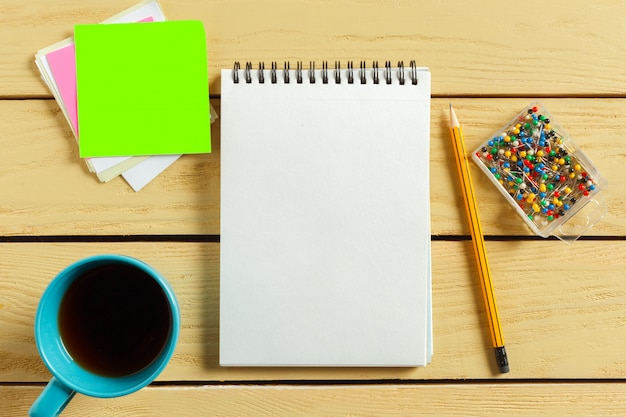 Top view. coffee cup with coffee. pen putting on blank notebook. Premium Photo