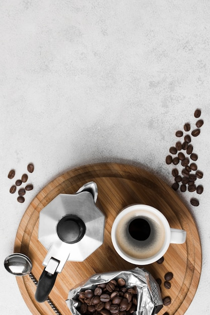 Top view coffee grinder with fresh hot beverage and copy space Free Photo