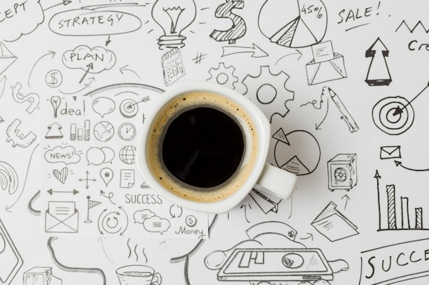 Top view coffee on papel full of doodles Free Photo