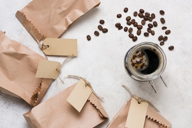 Top view coffee and paper bags with labels Free Photo