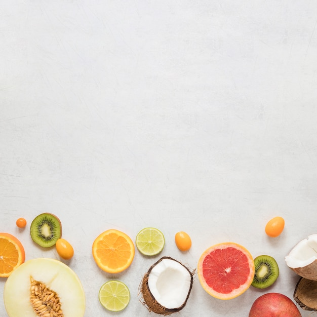 Top view collection of exotic fruits with copy space Free Photo