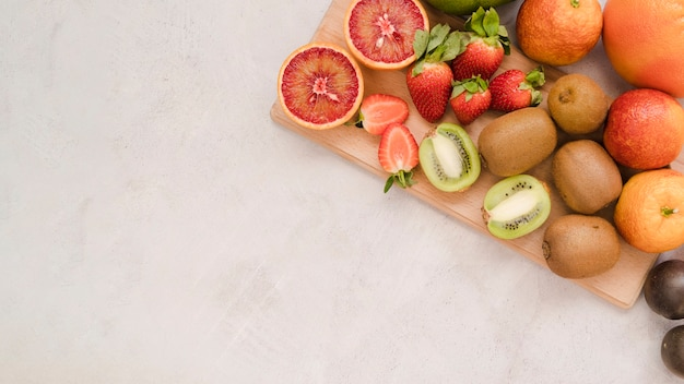 Top view collection of tasty fruits with copy space Free Photo
