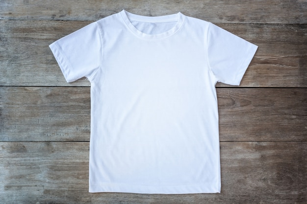 Top view of color t-shirt on grey wood plank background Premium Photo