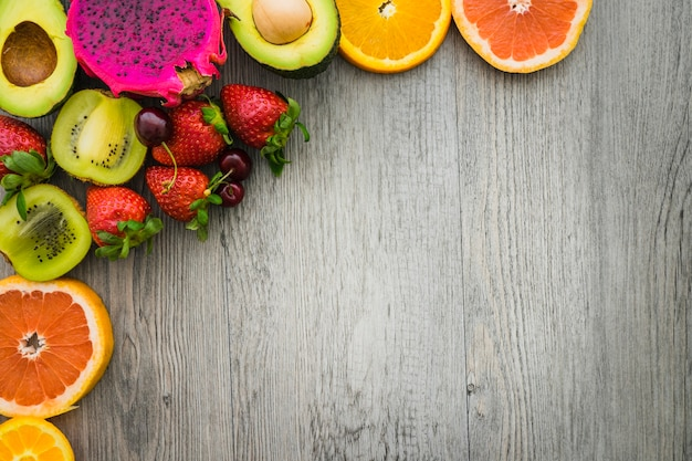 Top view of colored fruits with blank space Free Photo