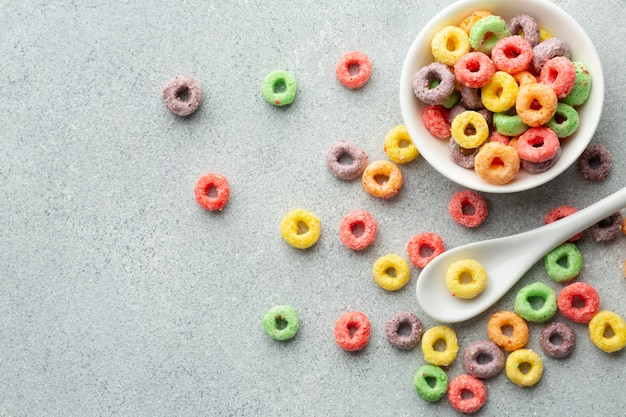 Top view colorful cereal and plastic spoon Free Photo