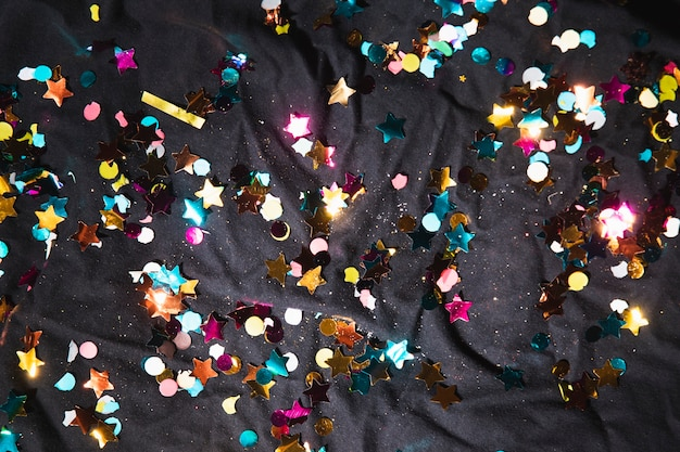 Top view colorful confetti for party Free Photo