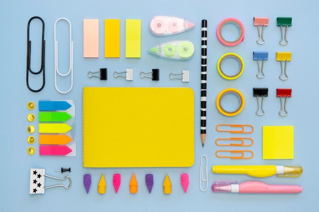 Top view of colorful office stationery with paper clips and erasers Free Photo